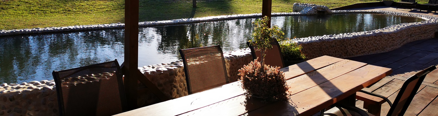 natural swimming pool outside seating area