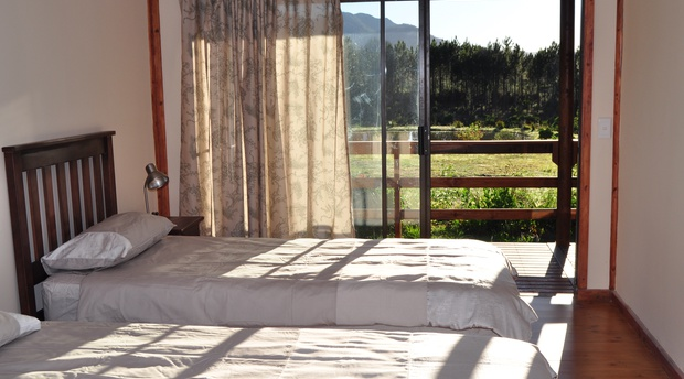 cottage accommodation garden route with twin beds mountain garden views